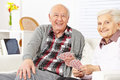 Senior couple playing cards at home Stock Photography