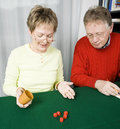 Senior couple playing dice Stock Image