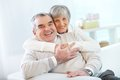Senior couple portrait of a happy women embracing her husband and both looking at camera Royalty Free Stock Photography