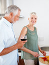 Senior couple preparing food in the kitchen Stock Photo