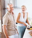 Senior couple preparing food in the kitchen Stock Images