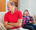 Senior couple after quarrel in living room at home Stock Photos
