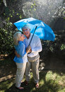 Senior Couple in Rain Stock Images