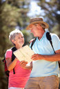 Senior couple reading map on country walk Royalty Free Stock Photo
