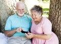 Senior Couple Reads Text Message Royalty Free Stock Photo