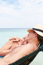 Senior couple relaxing in beach hammock together Royalty Free Stock Photography