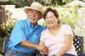 Senior Couple Relaxing In Garden Together Royalty Free Stock Images