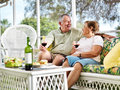 Senior couple relaxing outside on patio Royalty Free Stock Images