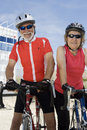 Senior Couple Riding Bicycle Stock Photo