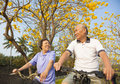 senior couple riding bicycle  in the park Royalty Free Stock Photo