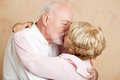 Senior couple romantic kiss in their eighties exchanging a passionate Royalty Free Stock Images