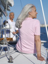 Senior couple on sailing boat rear view of woman Stock Photo