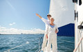 Senior couple sailing on boat or yacht in sea age tourism travel and people concept happy pointing finger to something sail deck Stock Photos