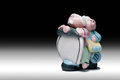Senior couple on scooter ceramic figure of two smiling old folks riding graduated background Royalty Free Stock Image