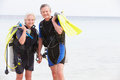 Senior couple with scuba diving equipment enjoying holiday smiling to camera Royalty Free Stock Image