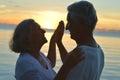 Senior couple at sea at sunset Royalty Free Stock Photo