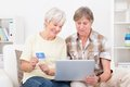 Senior couple shopping online happy using laptop with credit card Stock Images