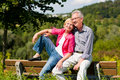 Senior couple sitting on bench Royalty Free Stock Photography