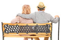 Senior couple sitting on a bench rear view isolated white background Royalty Free Stock Photo