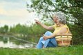 Senior couple sitting happy in summer near lake Royalty Free Stock Photo