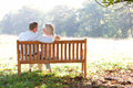 Senior couple sitting outdoors Royalty Free Stock Photo