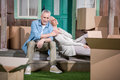 Senior couple sitting together on stairs of new house, relocation concept Royalty Free Stock Photo