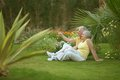 Senior couple sitting at tropic hotel garden on vacations Stock Photos