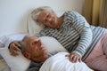 Senior couple sleeping on bed in nursing home Royalty Free Stock Photo