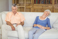 Senior couple sleeping on sofa in living room Royalty Free Stock Photo