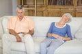 Senior couple sleeping on sofa in living room Royalty Free Stock Photo