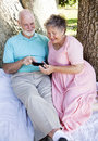Senior Couple with Smart Phone Stock Photos