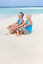 Senior Couple In Sports Clothing Relaxing On Beautiful Beach Royalty Free Stock Photo