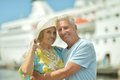 Senior couple standing on pier at the resort during vacation Stock Photo