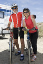 Senior Couple Standing By Their Bicycles Stock Photography