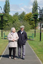 Senior couple strolling in the park Royalty Free Stock Photo