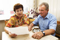 Senior couple studying document Royalty Free Stock Photo