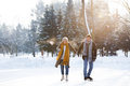 Senior couple in sunny winter nature ice skating. Royalty Free Stock Photo