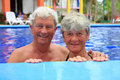 Senior couple in swimming pool. Stock Photography