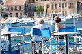 Senior couple in symi greece enjoying the view from a terrace close to the harbour Royalty Free Stock Image