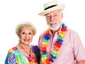 Senior couple takes a vacation on tropical dressed for summertime isolated on white Stock Photos