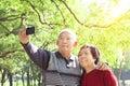 Senior couple taking picture Royalty Free Stock Photo