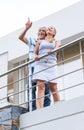 Senior couple terrace balcony modern house Royalty Free Stock Photo