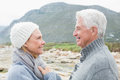 Senior couple together on a rocky landscape side view of romantic Royalty Free Stock Photo