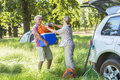 Senior Couple Unpacking Car For Camping Trip In Countryside Royalty Free Stock Photo