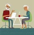 Senior couple using laptop trendy drinking tea Stock Images