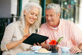 Senior Couple Using Tablet Computer Cafe Stock Images