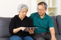 Senior couple using tablet at home Stock Photo