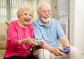 Senior Couple - Video Gaming Royalty Free Stock Photo