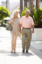 Senior Couple Walking Along Street Together Royalty Free Stock Photo