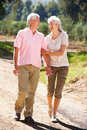 Senior couple walking in country Stock Photo